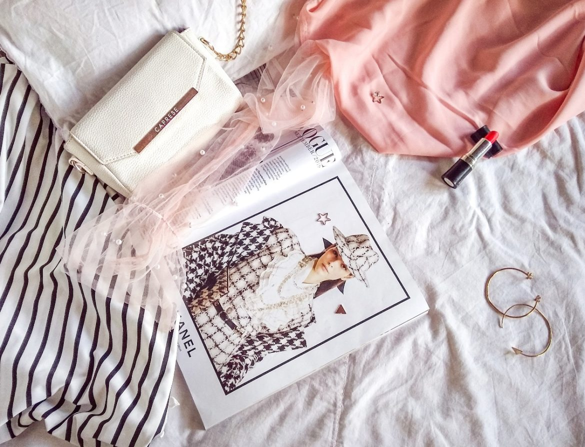 Fashion articles arranged in a flatlay