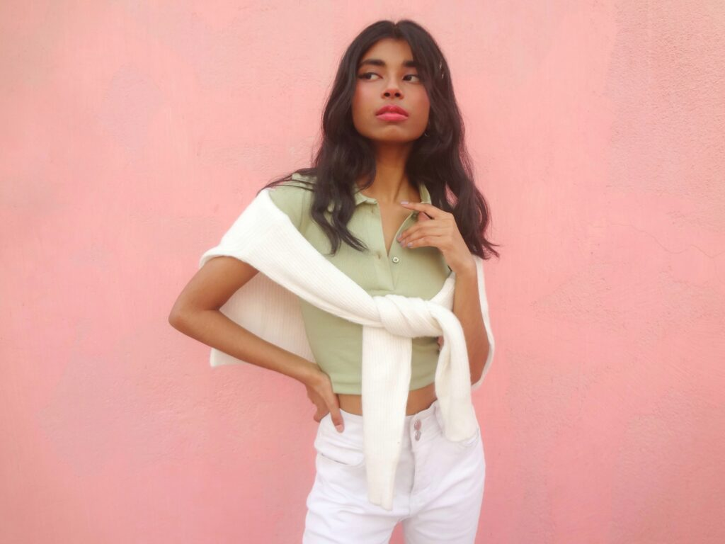 An Asian fashion blogger in her teen styling a 90s polo tee with white sweater and jeans in order to style pastels.