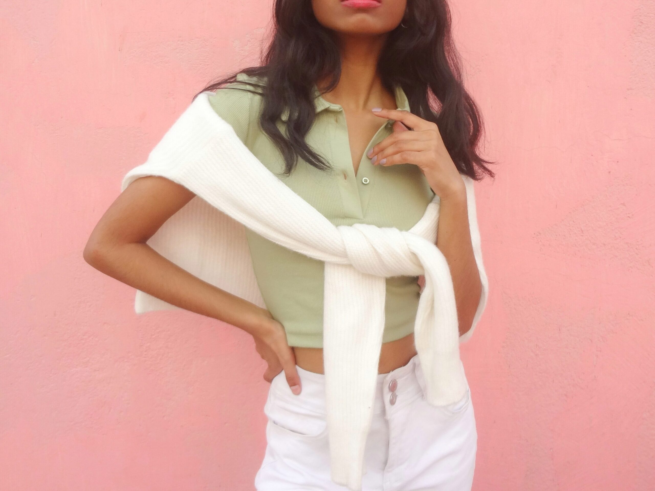 a sage green or pastel green cropped polo styled with cream sweater and white jeans for a soft girl aesthetic outfit.